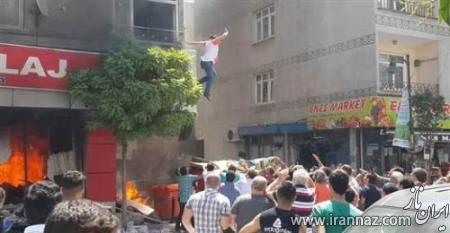پرش اعجاب انگیز زن باردار از ساختمان آتش گرفته (عکس)