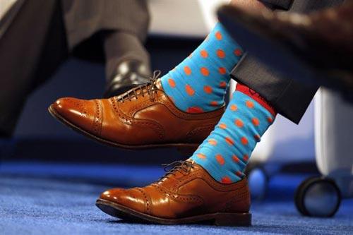 جوراب های رنگی مرد میلیاردر رسانه ای جهان (عکس)