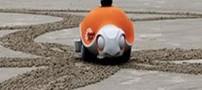 ایجاد نقوش روی ماسه با ربات لاک پشت (عکس)