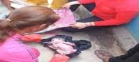 نوزاد یک روزه در سطل زباله (عکس)