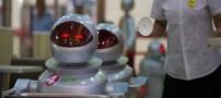 در این رستوران ربات ها گارسون هستند (عکس)