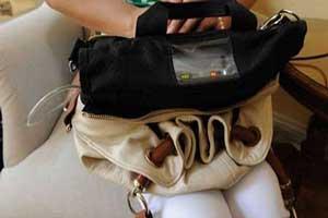 زنی که قلبش در کیفش قرار گرفته است! (عکس)