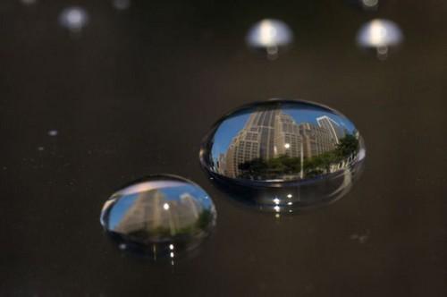 عکس هایی از نمایان شدن شهرها در قطره های آب