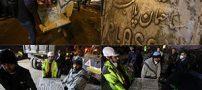 تابلوی ساختمان پلاسکو از زیر آوار خارج شد +تصاویر
