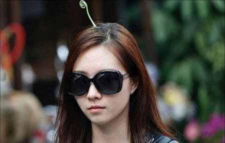 کار عجیب مردم پکن، کاشت گیاه روی سرشان (عکس)