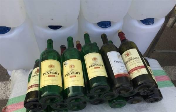 انهدام باند مخوب تولید مشروبات الکلی تقلبی (عکس)