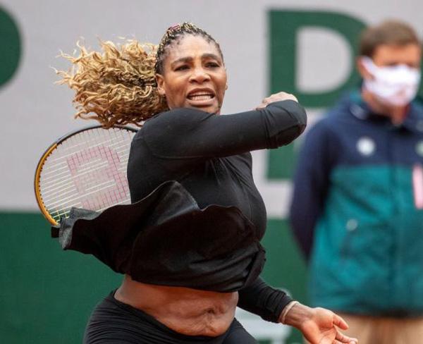 راز شکم بزرگ و افتاده خانم ورزشکار دارنده مدال طلا ( عکس )
