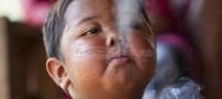 عکسهای سیگار کشیدن یک پسر بچه 2ساله!!