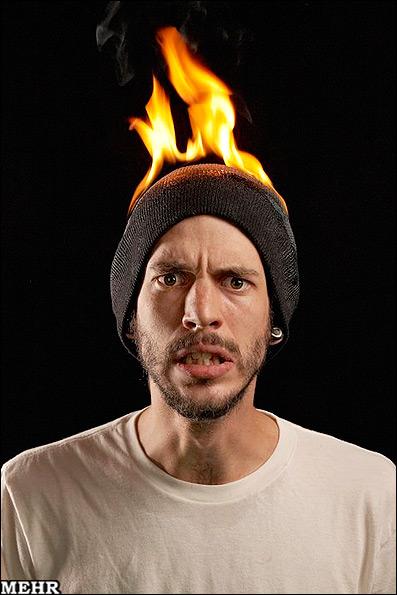 بدلکاران چگونه خود را آتش می زنند؟! (+عکس)