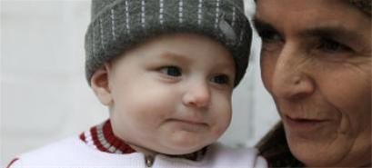 پدیدار شدن آیات قرآن بر بدن یک نوزاد (+عکس)