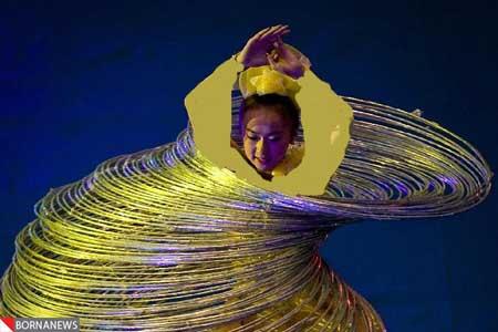 رکورد دختری چینی با رقص با 105 هولاهوب +تصاویر