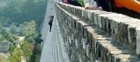 بالا رفتن زنی از دیوار 21 متری برای نپرداختن حق ورود