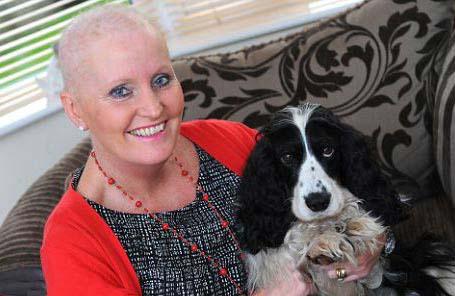تشخیص غده سرطانی زنی توسط سگ وفادار+عکس