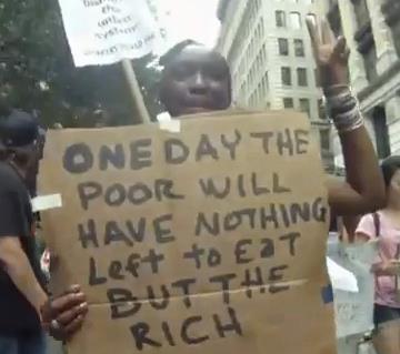 اعتراض بسیار جالب زن سیاه پوست آمریکایی +عکس