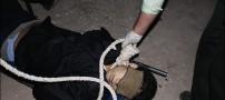 عکس هایی از مراسم اعدام قاتل روح ا… داداشی