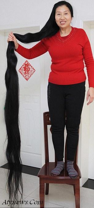 زنی که موهایش از قدش بلند تر است + عکس