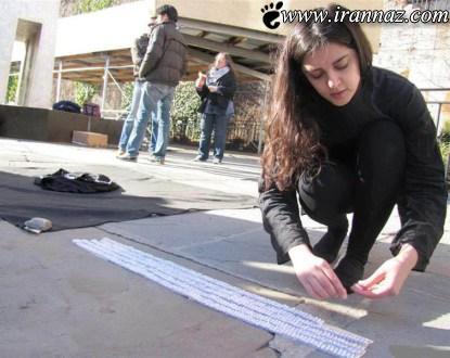 حرکت زیبای یک دختر ایرانی مقابل سازمان ملل (عکس)